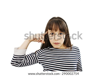 Closeup portrait angry mad teenager girl gesturing with her finger against temple asking are you crazy? Isolated on white background. Negative human emotions facial expression feeling body language    - stock photo