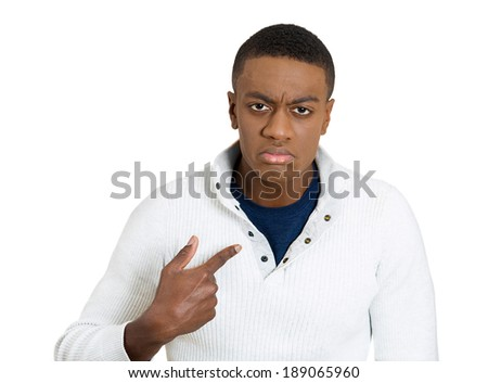 Closeup portrait, angry, unhappy, annoyed young man, getting mad, asking question you talking to, mean me? Isolated white background. Negative human emotions, facial expressions, feelings, reaction