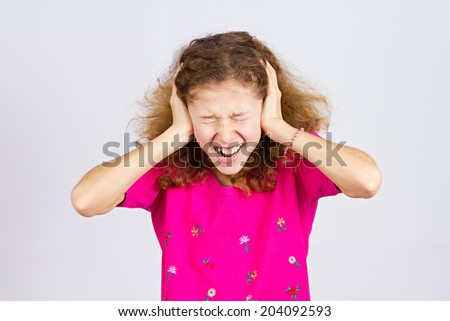 Closeup portrait angry upset, stressed little young girl, having nervous breakdown, screaming isolated grey background. Negative human emotion facial expression, feeling attitude, reaction perception