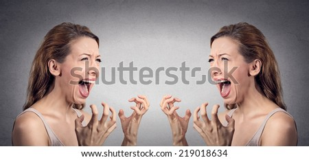 Closeup portrait angry woman hysterical having nervous breakdown screaming pissed off  at herself in mirror isolated grey wall background. Negative human emotion facial expression feeling bad attitude - stock photo