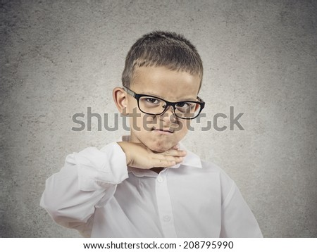 Closeup portrait angry young bitter boy gesturing with hand to stop talking, cut it out, he will take your head off isolated grey background. Negative emotion, facial expression feelings body language - stock photo