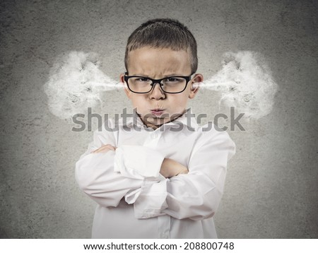 Closeup portrait Angry young Boy, Blowing Steam coming out of ears, about have Nervous atomic breakdown, isolated grey background. Negative human emotions, Facial Expression, feeling attitude reaction - stock photo
