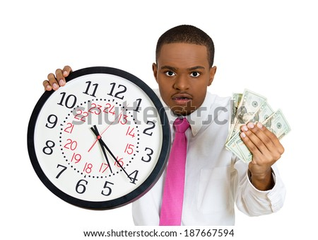 Closeup portrait, angry young business corporate boss ceo man, holding clock and dollar bills up. Time is money concept, isolated white background. Positive human emotions facial expression feelings. - stock photo