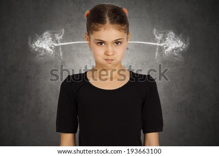 Closeup portrait angry young girl, blowing steam coming out of ears, about have nervous atomic breakdown, isolated black background. Negative human emotions facial expression feeling attitude reaction - stock photo