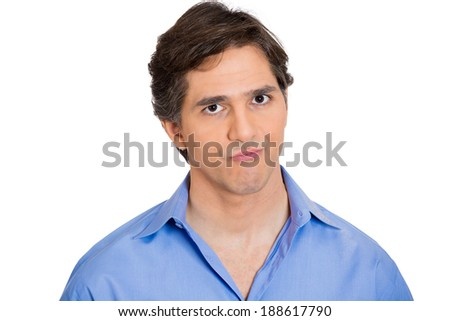 Closeup portrait, annoyed, grumpy business man, employee, worker looking suspicious, isolated white background. Human emotions, face expressions, reaction, interpersonal conflict resolution - stock photo
