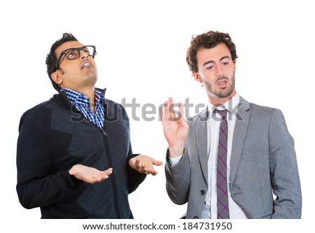 Closeup portrait, annoyed nerd man with black glasses by what a business guy in suit is telling him, talk to hand, isolated white background. Negative human emotion facial expression feelings. - stock photo