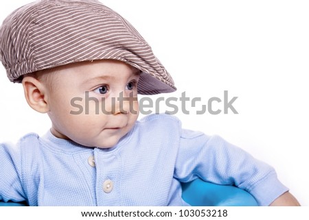 closeup portrait baby on a white background wearing hat - stock photo