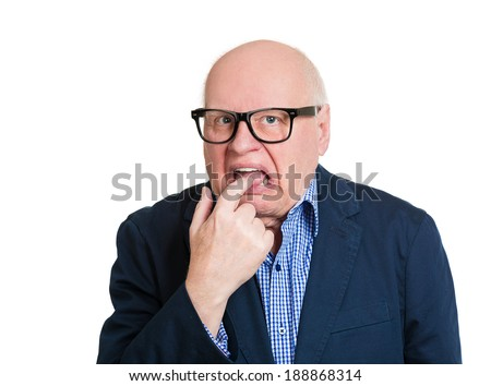 Closeup portrait, bald, senior, nerd mature man in big black glasses, finger in mouth, something sucks, isolated white background. Negative human emotions, facial expressions, feelings - stock photo