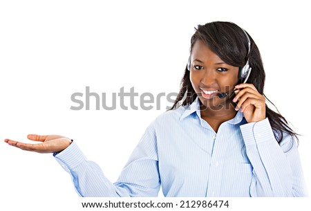 Closeup portrait beautiful smiling female customer representative with phone headset pointing at copy space with hand isolated white background. Positive human emotions, facial expressions, attitude - stock photo