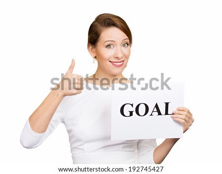 Closeup portrait beautiful smiling, happy business woman holding sign goal, giving thumbs up isolated white background. Positive emotion, facial expression, reaction, attitude, determination, dynamism