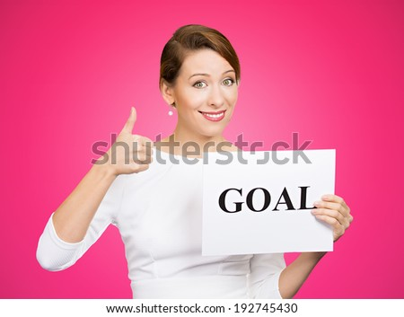 Closeup portrait beautiful smiling, happy business woman holding sign goal, giving thumbs up isolated pink background. Positive emotions, facial expressions, reaction, attitude, determination  - stock photo