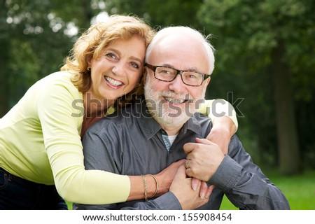 Closeup portrait beautiful woman embracing handsome man - stock photo