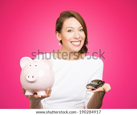 Closeup portrait, beautiful, young woman, dealership agent holding model black car, pink piggy bank in hand, offering credit line, isolated pink background. Lease, automobile purchase, financing.