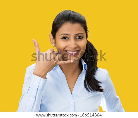 Closeup portrait, beautiful young woman showing call me phone hand sign gesture, smiling, happy, isolated yellow background. Positive human emotion facial expression feelings, body language, symbols - stock photo