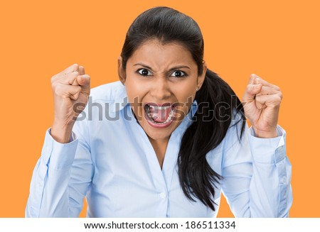 Closeup portrait, bitter displeased pissed, angry, cranky, grumpy, woman teeth, fists in air, screaming, shouting, yelling isolated orange background. Negative human emotion facial expression feeling - stock photo