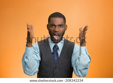 Closeup portrait bitter mad, displeased pissed off, angry grumpy corporate man, open mouth, hands in air, screaming yelling isolated orange background. Negative human emotion facial expression feeling - stock photo