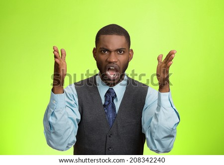 Closeup portrait bitter mad, displeased pissed off, angry grumpy corporate man, open mouth, hands in air, screaming, yelling isolated green background. Negative human emotion facial expression feeling - stock photo