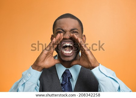 Closeup portrait bitter mad, displeased pissed off, angry grumpy corporate man, open mouth, hands in air, screaming yelling isolated orange background. Negative human emotion facial expression feeling