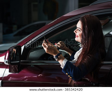 Closeup portrait, cheerful, joyful, smiling, beautiful business lady holding up keys to her first new business class car.Emotions gestures - stock photo