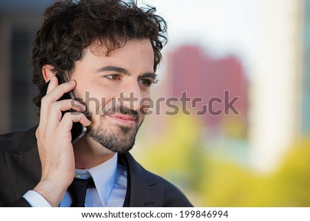 Closeup portrait, classy looking, handsome young, smiling business man talking on cell phone relaxed on balcony his apartment isolated city background. Urban life style, corporate professional worker
