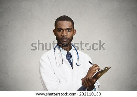 Closeup portrait, confident young male family doctor, assistant cardiologist, health care professional taking notes from patient isolated black, grey background. Positive human emotion face expression - stock photo
