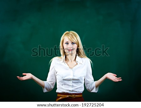 Closeup portrait confused, worried blonde young woman asking with hands, not sure which way, where to go in life, isolated green background. Emotion, facial expression, feeling, reaction, perception - stock photo