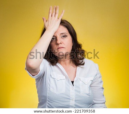 Closeup portrait confused young woman placing hand on head, palm on face gesture in duh moment isolated yellow background. Negative emotion facial expression feeling body language, life perception - stock photo