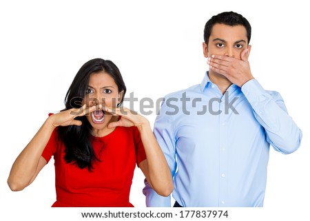 Closeup portrait couple, man, woman, corporate workers, one being noisy, screaming, yelling, other quiet, calm, thoughtful, modest, covering closed mouth isolated on white background. Emotion contrast - stock photo