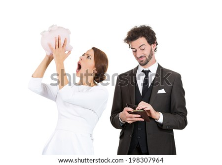 Closeup portrait couple, stressed woman holding shaking empty piggy bank, looking upset from financial problems, happy business man pulling out cash money from wallet with smirk on face isolated white - stock photo