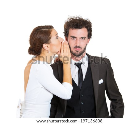Closeup portrait couple young lovers share secrets, amazed man listening gossip in the ear, unexpected turn of events isolated white background. Human face expression emotion reaction life perception  - stock photo