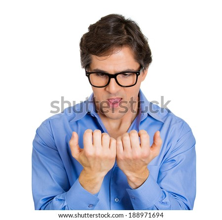 Closeup portrait, crazy, perfectionist, young adult man, funny nerd black glasses, anxiously staring at fingernails, making sure they clean isolated white background. Face expression emotions - stock photo