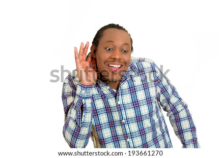 Closeup portrait, curious young, nosy, surprised man hand to ear, secretly listen in on juicy gossip, conversation, news, surprised happy what he hears, privacy violation, isolated white background - stock photo
