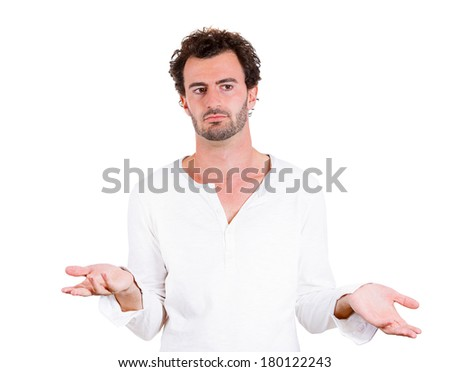 Closeup portrait dumb, clueless young man, arms out asking what's problem, who cares, so what, I don't know isolated on white background. Negative human emotions, facial expressions, attitude reaction
