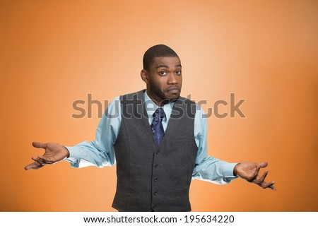 Closeup portrait dumb looking, clueless business man, arms out asking why, what's problem, so what, I don't know, isolated orange background. Negative human emotion facial expression, life perception - stock photo