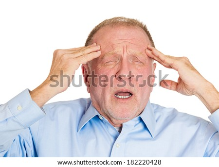 Closeup portrait elderly business man, grandfather suffering from severe migraine,  isolated white background. Geriatrics, mental health issues, depression. Emotion, facial expression, life perception - stock photo