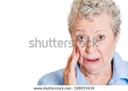 Closeup portrait, elderly business woman with tooth ache, crown problem, cavity pain, touching outside mouth with hand, isolated white background. Negative human emotion facial expression feeling - stock photo