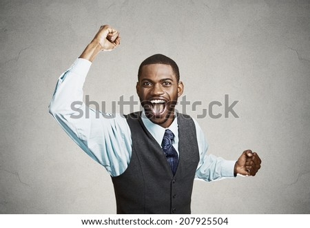 Closeup portrait excited, energetic, happy, screaming student, business man winning, arms, fists, hands pumped, celebrating success isolated grey background. Positive human emotion facial expression - stock photo