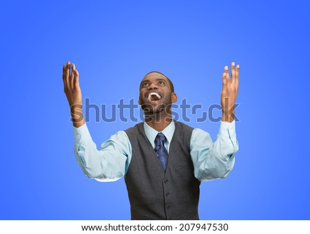 Closeup portrait excited, energetic, happy, screaming student, business man winning, arms, fists hands pumped, celebrating success isolated blue background. Positive human emotion, facial expression - stock photo