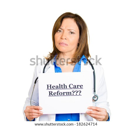 Closeup portrait female health care professional doctor with stethoscope holding up sign health care reform? isolated white background. Obamacare, medicaid, legislation debate, insurance plan coverage - stock photo