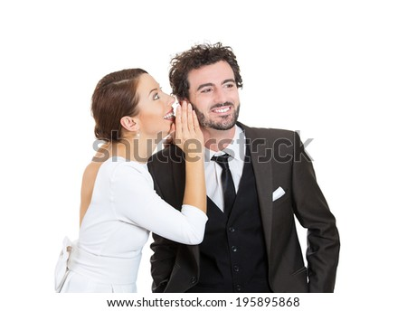 Closeup portrait girl whispering into man's ear telling him something funny shocking. Happy smiling cheerful toothy response. Positive communication human emotion face expression feeling body language