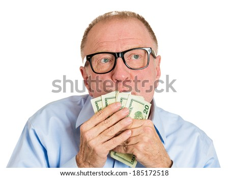 Closeup portrait, greedy senior executive, CEO, boss, old corporate employee, mature man, holding, kissing dollar banknotes in hand, isolated white background. Negative human emotion facial expression - stock photo