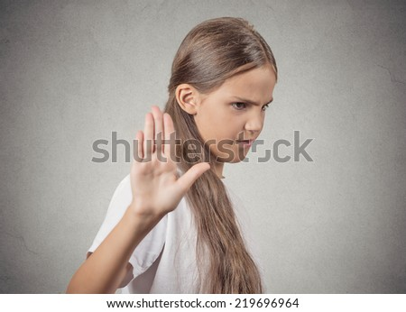 Closeup portrait grumpy teenager girl with bad attitude giving talk to hand gesture with palm outward, isolated grey wall background. Negative emotions, facial expression feelings, body language - stock photo
