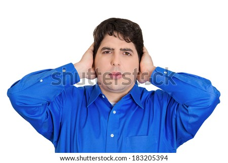 Closeup portrait handsome peaceful, tranquil, looking relaxed, young business man covering his ears, observing eyes, isolated white background. Hear no evil concept. Human emotion, facial expressions - stock photo