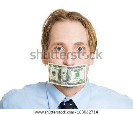 Closeup portrait handsome young corrupt man in blue shirt, black tie, hundred dollar bill taped to mouth, isolated white background. Bribery concept in politics, business, diplomacy. Life perception - stock photo