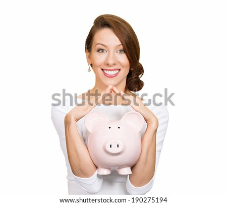 Closeup portrait, happy, business woman, bank employee, hugging piggy bank, arms shaped like house, isolated white background. Financial savings concept. Positive human emotions, facial expression - stock photo