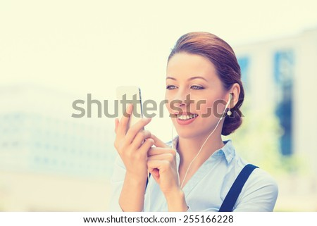 Closeup portrait happy cheerful girl excited by what she sees on cell phone isolated background corporate office. Face expression reaction. Business woman sending text message from mobile smartphone - stock photo