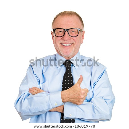 Closeup portrait happy, confident, cheerful, smiling senior mature man in black glasses with arms crossed thumbs up, isolated white background. Positive human emotion, facial expression, attitude - stock photo