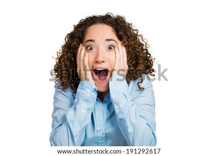 Closeup portrait happy, cute, young beautiful woman looking excited, surprised, full disbelief, hands on cheeks, it's me? isolated white background. Positive human emotion, facial expression, reaction