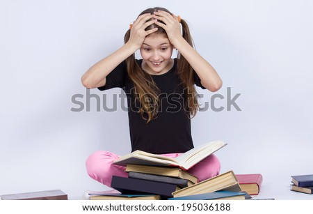 Closeup portrait happy, excited, smiling, funny looking little girl, surprised, shocked, reading book, discovered something new, isolated grey background. Human facial expressions, emotions, feeling - stock photo