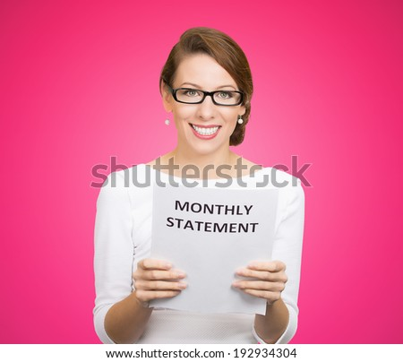 Closeup portrait happy excited young business woman looking at monthly statement glad to pay off bills, isolated pink background. Positive emotions, facial expressions. Financial success, good news